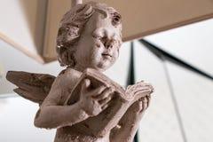 Angel children read book architecture stock image