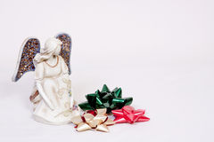 Angel and Christmas bows. Angel with green, gold and red Christmas bows Royalty Free Stock Photo