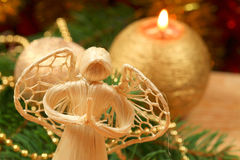 Angel and Christmas decoration. Praying angel and Christmas golden decoration in background Royalty Free Stock Images