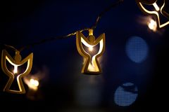 Angel shaped christmas lights Stock Photography