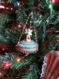Angel Christmas ornament. Ceramic angel Christmas ornament on a holiday tree stock photo