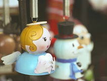 An Angel Christmas Ornament with Frosty and Santa Royalty Free Stock Image