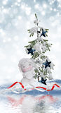 Angel and Christmas tree Stock Photography