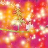 Angel and Christmas tree Stock Photos