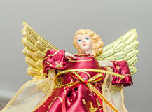 Angel Christmas tree ornament, topper, close up. Dressed angel with wings Royalty Free Stock Images