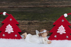 Angel and Christmas trees Stock Photography