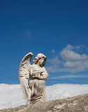 Angel with clouds. An Angel on the wall of a french cemetery Royalty Free Stock Photos