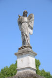 Angel. Column with Angel next to old Roman Church Royalty Free Stock Images