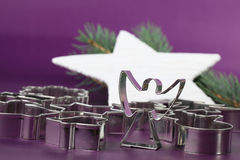 Angel cookie cutter on Christmas background stock photo