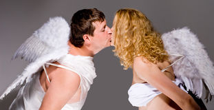 Angel couple kissing Stock Photo