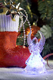 Angel and cristmas stocking with presents Royalty Free Stock Photo