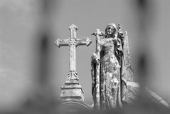 Angel and Cross. Detail Angel and Cross of a  Catholic cemetery Royalty Free Stock Images