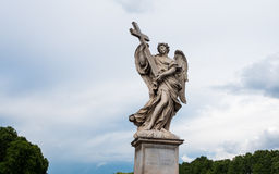 Angel with the Cross on the Bridge of Hadrian - Ponte Sant'Angelo in Rome, Italy Royalty Free Stock Photo