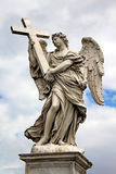 Angel with cross at the famous Sant' Angelo bridge in Rome, Ital Stock Images