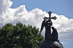Angel, Cross and King. An angel, cross and king silhouetted against the clouds - taken in the Kremlin, Novgorod, Russia royalty free stock photo