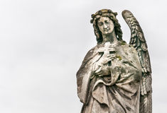 An angel with a cross. Royalty Free Stock Photo