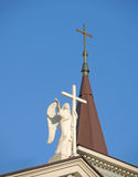 Angel with a cross on the roof Royalty Free Stock Image