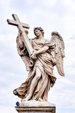 Angel with the Cross statue on Ponte Sant Angelo bridge in Rome Royalty Free Stock Images