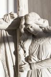 Angel with cross. Statue of a pure angel holding a cross with eyes closed Stock Photo