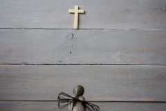 A angel and cross. On wooden background stock photos