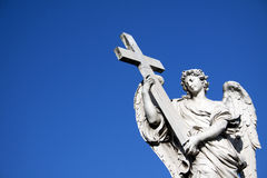 Angel with crucifix. Near Castel St. Angelo in Rome, Italy Royalty Free Stock Photos