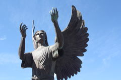 Angel Crying Out. Statue of an Angel hands reaching out to the heavens Royalty Free Stock Photography