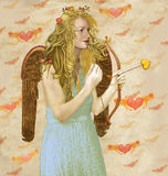 Angel Cupid. A golden winged angel is poised with a cupid styled bow and arrow.The arrow is a golden amber colour and texture. This beautiful angel wears a rose Royalty Free Stock Photos
