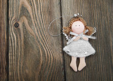Angel. Cute Christmas angel over old wooden background Royalty Free Stock Photography