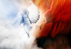 Angel and demon. A heavenly angel with white wings wards off a winged devil or demon within a wall of flames royalty free illustration