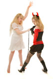 Angel and demon fighting royalty free stock photos