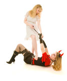 Angel and demon fighting stock photography