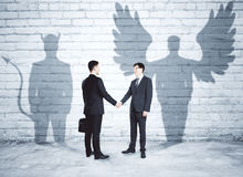 Angel and demon partners Stock Images