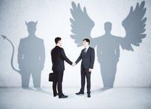 Angel and demon partners Stock Photo