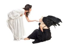 Angel and devil. Two girls representing scene between angel and devil Royalty Free Stock Photography