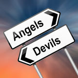 Angel or devil concept. Illustration depicting a roadsign with an angel or devil concept. Abstract blur background Stock Images