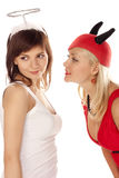 Angel and devil girls over white Stock Photography