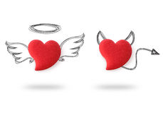 Angel and devil hearts stock photography