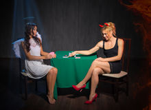 Angel and devil playing cards Stock Photos