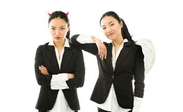 Angel and devil sides of a young Asian Royalty Free Stock Photography