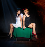 Angel and devil. On table royalty free stock photography