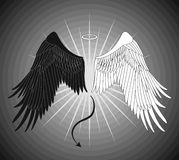 Angel and devil wings. On a gray background Royalty Free Stock Photography