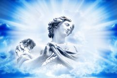 Angel in divine light. Beautiful angel in rays of divine light Stock Photos