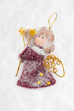 Angel doll made from fabric on snow Stock Photography