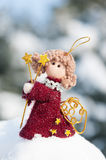 Angel doll on snowdrift Royalty Free Stock Photography