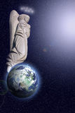 Angel and earth. Angel above earth in open cosmos among stars royalty free stock photos