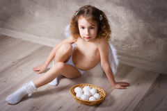 Angel with eggs Stock Photo
