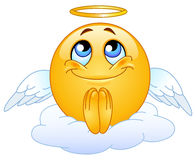 Angel emoticon. Sitting on a cloud Royalty Free Stock Photo