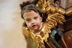 Angel Face at Loreta, Prague. Detail of an Angel Sculpture at Loreta, a large pilgrimage destination in Hradcany, Prague, Czech Republic Royalty Free Stock Images