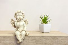 Angel figure on book shelf with copyspace Royalty Free Stock Photo