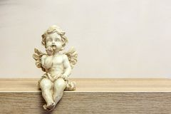 Angel figure on book shelf with copyspace Stock Image
